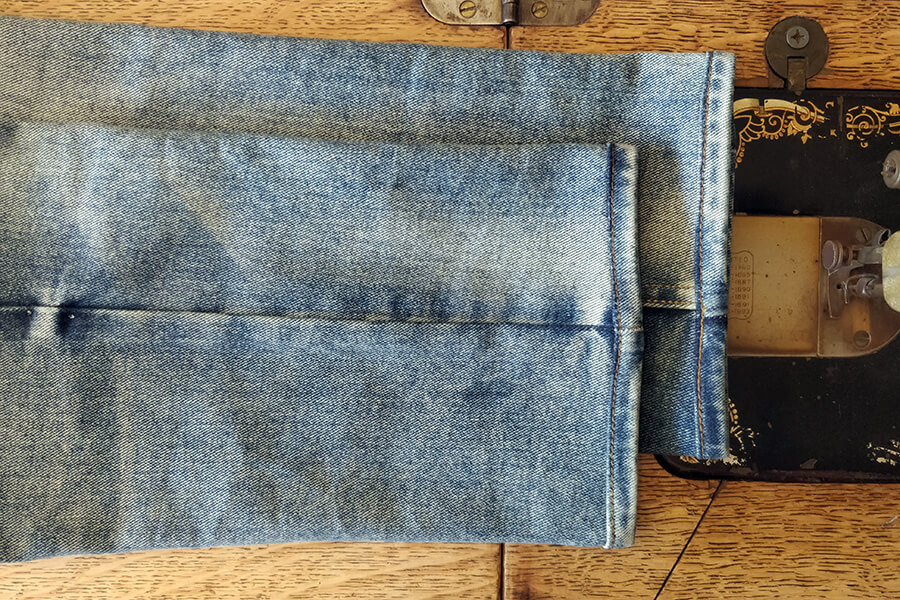 shortened jeans with reattached hem