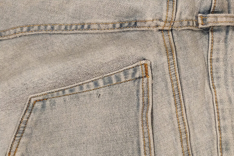 repaired jeans back pocket using darning
